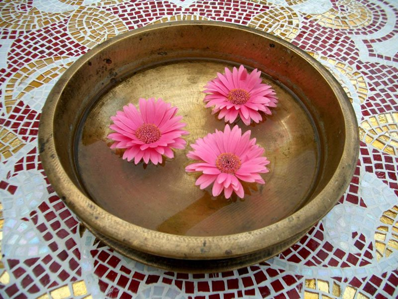 Bronze bowl of pink flowers